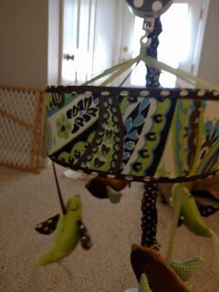 Crib set that includes diaper stacker and mobile