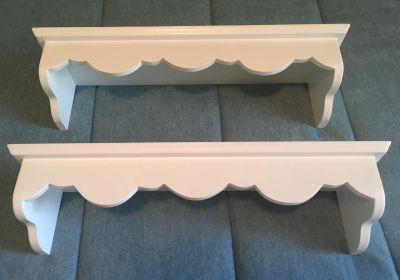 Pair of scalloped front white wood wall shelves