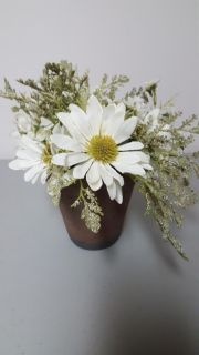 Faux flowers in a clay pot