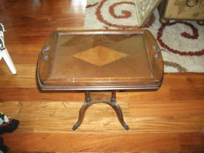 ANTIQUE ALL WOOD TABLE WITH A GLASS TOP USED FOR A SEVING TRAY