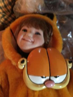 porcelain doll dressed as Garfield for Halloween