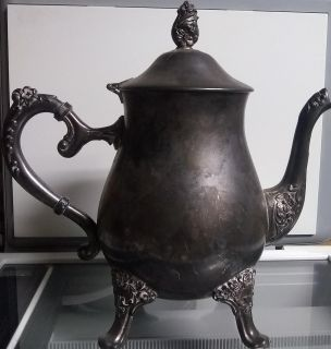 Silver teapots, sugar scuttle, and gravy boats