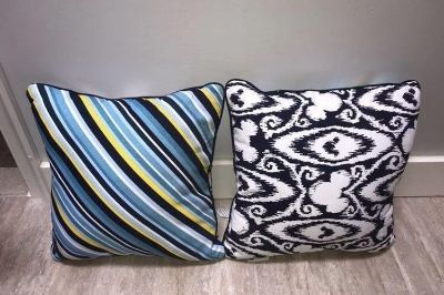 2 reversible Mickey themed throw pillows