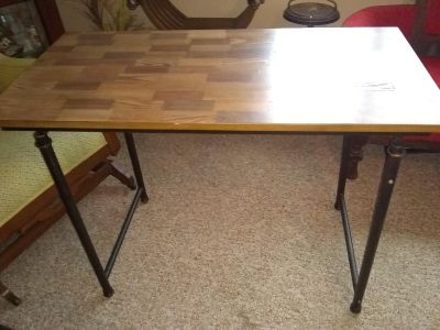 Very nice wood table for crafts desk etc. Rod iron style legs looks rustic. Excellent shape
