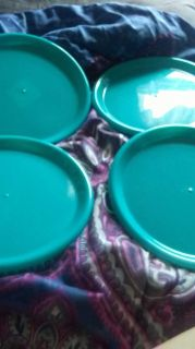 4 blue plastic plates some scratches but still.useable. great for dorm rooms