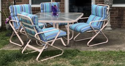 Patio Table and chairs and loungers.