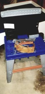 kids toy workbench and bag of tools