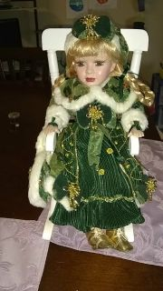 Porcelain doll sitting in rocking chair