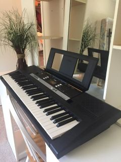 Piano/ Yamaha PSR E243, plus music rest, sustain peddle, headphones, stand and seat