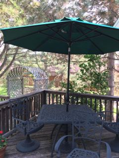 5 piece outdoor table and 4 chairs. Including $200 umbrella and stand. Heavy duty. Can stay out all year
