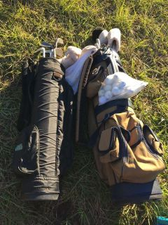 Two bags of golf with balls all for 20.