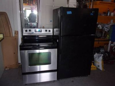 Kenmore Black Refrigerator and Whirlpool Black Glass Top Stove Set