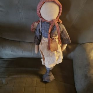 "Primitive doll on stand 17""tall"