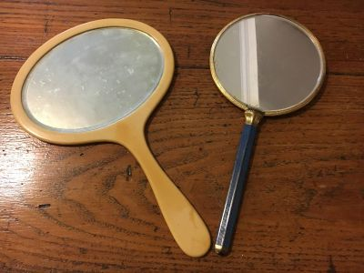 Two vintage hand held mirrors sold together one is bacalat