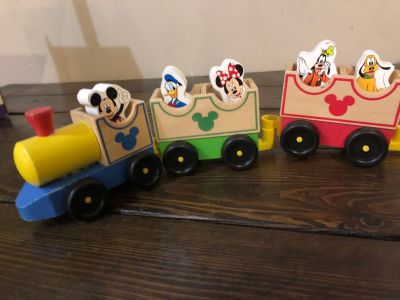 Wooden Mickey train with characters.