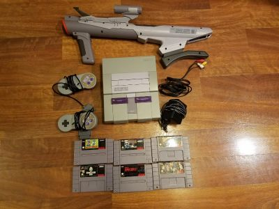 Super nintendo with super scope and games