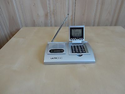 Ultronic portable am/fm radio with calendar, world time, calculator