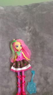 Monster high doll ? With brush.
