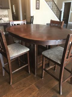 Bar top height table and four chairs