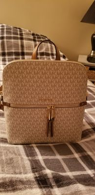 New with tags! Authentic Michael Kors backpack. Really cute. Roomey! Paid alot for it!! FIRM ON PRICE. Extremely cute!!! Great for summer!!!