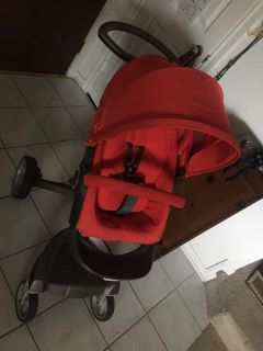 BEAUTIFUL BRIGHT RED STOKKE STROLLER.....EXCELLENT CONDITION