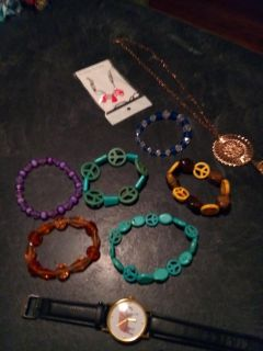 A bundle of nine pieces of jewelry bracelets necklace and watch all four $5