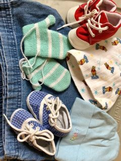 Lot of baby hats, shoes and mittens
