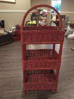 Three tier red wood and wicker basket stand