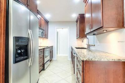 Kitchen in Cherry-wood cabinets and granite counters!