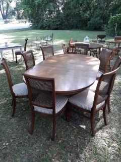 Dining room table vintage with 3 leaves 8 came back chairs