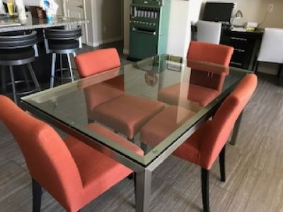 Crate and Barrel stainless and glass dining table and chairs