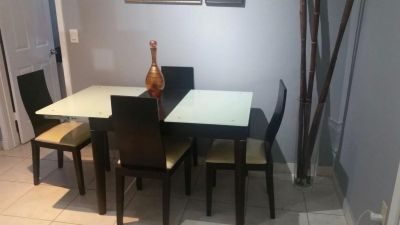 Dining table with four(4) chairs and vase