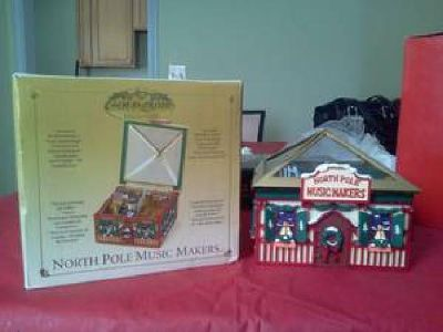 $25 Gold Abel Collections North Pole Music Makers Animated Workshop Scene