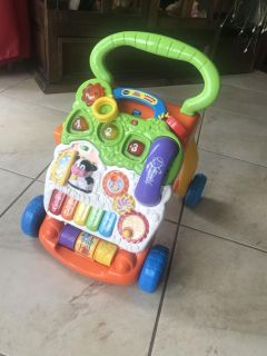 Vtech lights sound and music sit and stand baby walker like new!!