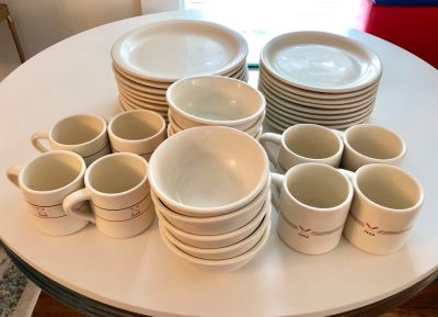 10 piece place setting West Elm stoneware dishes and 8 Feed mugs