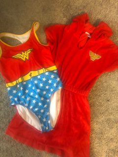 Like new swimming suit and coverup. Size 10/12.