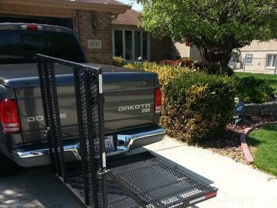 CARGO CARRIER WITH FOLDING RAMP