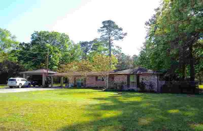 4700 N Tram Rd Vidor Three BR, This beauty sits amidst 3 acres in