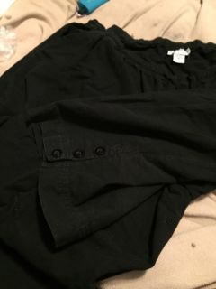2X black capris with button embellishments on legs