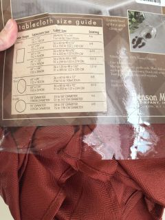 70 Round Tablecloth Rust Color-still in package