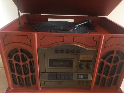 Director CD Recorder...Record Player...AM/FM Radio..Cassette Player....CD Player