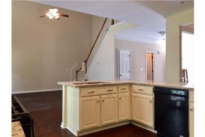 fireplace, upstairs loft, and hardwood floors through out. Gorgeous bricked backyard patio with perg