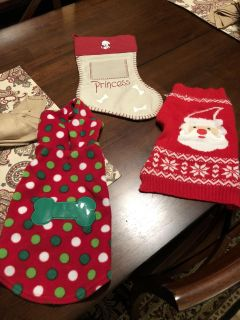 Dog stocking and 2 small dog sweaters