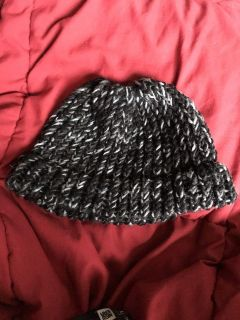 Handmade knitted messy bun toque. S/B free. Cat friendly home. Cross posted. Pick up Unicity or Polo Park Area.