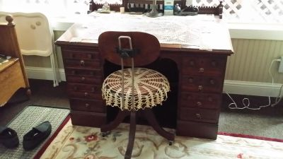 Antique desk and chair. The top lifts up to an attached antique typewriter