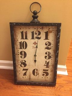 Large Antique looking distressed wall clock. Works. 26 tall 13.5 wide and 2.75 deep. Meet in White House near White House middle school