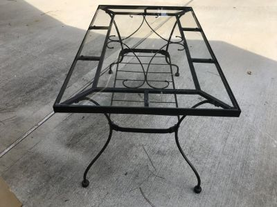 Iron table with tempered glass top