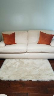 Cream leather sofa and chair with ottoman