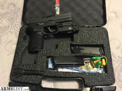For Sale: Sig Sauer P250 .40 with 357sig barrel