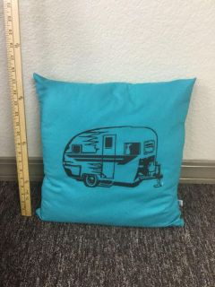 Fun throw pillow with vintage camper printed on front, front in VGUC, back has one small yellow spot. $3.00